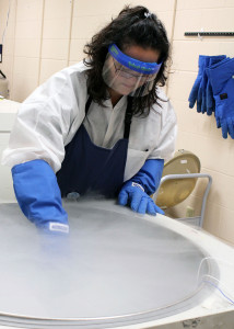 LifeCord's Teale Obana pulls a cord blood sample from liquid nitrogen storage prior to sending it to a patient. LifeCord donations have a global impact; the organization has helped patients in 27 different states and 12 foreign countries.